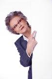 Senior lady with white banner Royalty Free Stock Photos