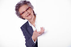 Senior lady with white banner Royalty Free Stock Photo