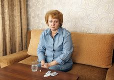 Senior lady woman with medication pills. Stock Photo