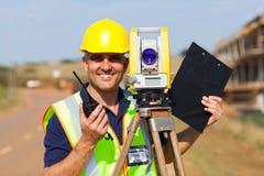 Senior land surveyor. Happy senior land surveyor with tacheometer on construction site royalty free stock photography