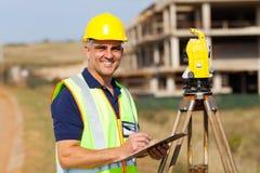 Senior land surveyor. Happy senior land surveyor at work royalty free stock photography