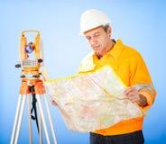 Senior land surveyor with theodolite Stock Photography