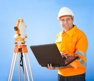 Senior land surveyor with theodolite Stock Photos