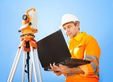 Senior land surveyor with theodolite Stock Image