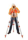 Senior land surveyor with theodolite Stock Photo