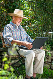Senior with a laptop Stock Photography