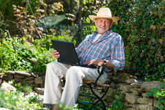 Senior with a laptop Royalty Free Stock Image