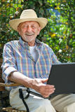 Senior with a laptop Stock Photos
