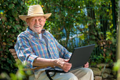 Senior with a laptop Royalty Free Stock Photography