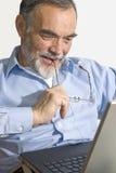 Senior on laptop Stock Photo