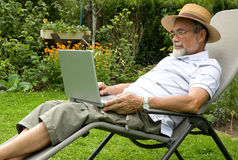 Senior on laptop Royalty Free Stock Image