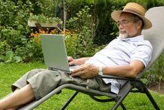 Senior on laptop Royalty Free Stock Image