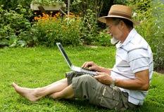 Senior on laptop Royalty Free Stock Photo