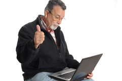 Senior with laptop computer Royalty Free Stock Images