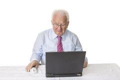 Senior with laptop computer. Senior using a laptop computer Stock Image