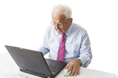 Senior with laptop computer. Senior using a laptop computer Stock Images