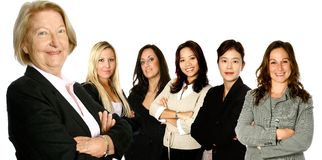Senior leader and 5 team. Mature female caucasian  leading a team of business women from diverse background made up of a caucasian, a mediterranean, an Asian and Stock Photography
