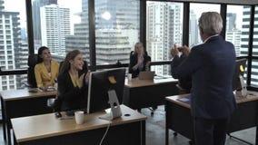 Senior leader giving advice speech to team members