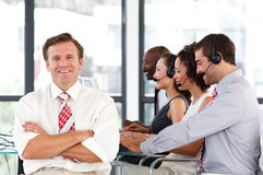 Senior leadership with folded arms in a call cente Stock Photography
