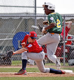 Senior league baseball world series aruba safe. BANGOR, MAINE - AUGUST 17: Jermain Manuel of Latin America (Aruba South L.L, San Nicolas, Aruba) is safe at first royalty free stock photos