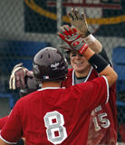 Senior league baseball world series high five. BANGOR, MAINE - AUGUST 18: Nic Cota (8) and Dylan Morris (15) exchange high fives for Maine District 3 (Bangor stock photo