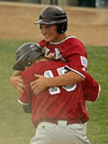Senior league baseball world series hug. BANGOR, MAINE - AUGUST 18: Dylan Morris (15) and Anthony Capuano celebrate a run for Maine District 3 (Bangor East/West royalty free stock images