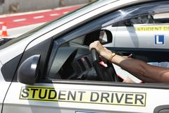 Senior learning to drive a car with a driving instructor stock photos