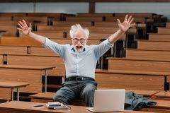 senior lecturer in empty lecture room screaming stock photos