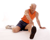 Senior Leg Stretches Stock Photography