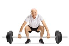 Senior lifting a barbell. Isolated on white background stock images