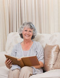 Senior looking at her photo album Royalty Free Stock Photos