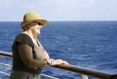 Senior looking over balcony. Senior lady enjoying the view over the balcony Stock Photography