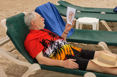 Senior on a lounge chair Royalty Free Stock Images