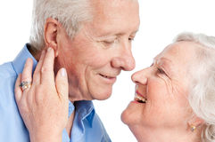 Senior love and care. Sweet loving senior couple flirting together during the old age isolated on white background Stock Photo