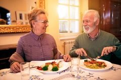 Senior lovely couple eating healthy lunch at nursing home. Enjoy together in beautiful  healthy food Stock Photos