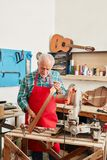 Senior luthier at his workshop Stock Images