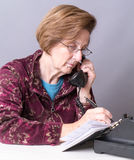 Senior Making an Appointment Stock Photography