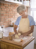 Senior making a cake Royalty Free Stock Photos