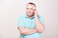 Senior making call Royalty Free Stock Photos
