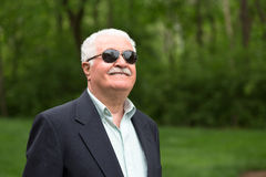 Senior Male Adult Looking up Trustfully with his Sunglasses Royalty Free Stock Photography