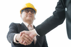 Senior male architect hand shaking Stock Image