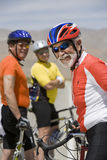Senior Male Cyclist With Friends Standing In The Background Stock Photography