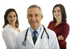 Senior Male Doctor with Administrators Stock Image