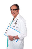 Senior male doctor holding blank clipboard Royalty Free Stock Photo