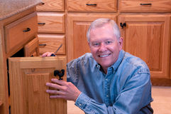 Senior male doing home repair Royalty Free Stock Photo