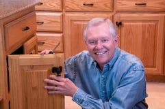 Senior male doing home repair Royalty Free Stock Photo