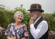 Senior male and female in 1940s clothing. In a rural setting stock images