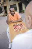 Senior Male Friends Playing Chess Royalty Free Stock Images