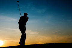 Senior male golf player at sunset Royalty Free Stock Images