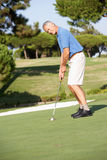 Senior Male Golfer On Golf Stock Photo